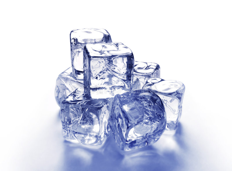Stack of ice cubes. Reflecting on white background with blue tint and copy space royalty free stock photography