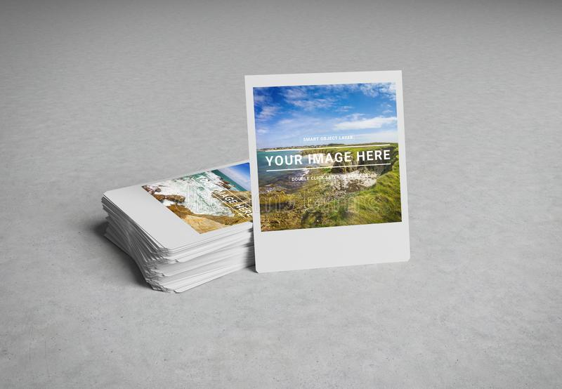 Stack of instant photos on concrete surface 3D rendering stock image