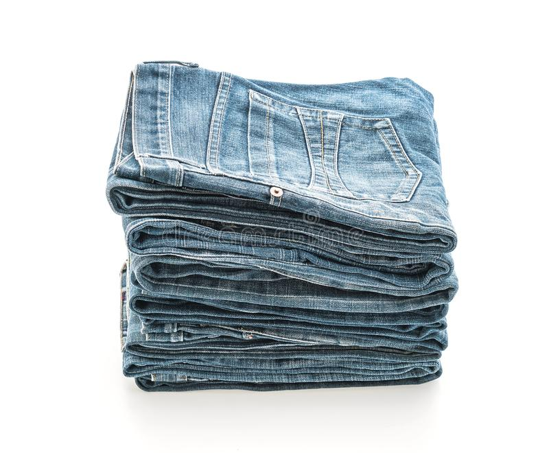 Stack of jeans folded on white background. Stack of jeans folded isolated on white background royalty free stock photography