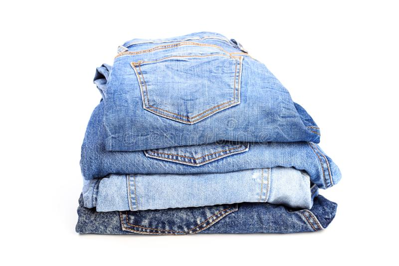 Stack of jeans pants on white background - Image. Stack of jeans pants on white background royalty free stock photography