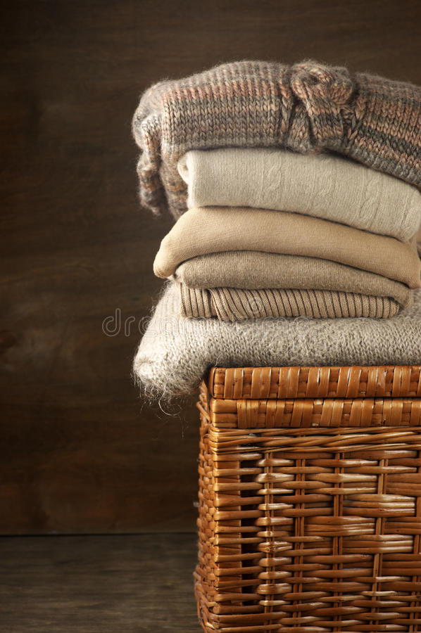 Stack of knitted sweaters stock photos
