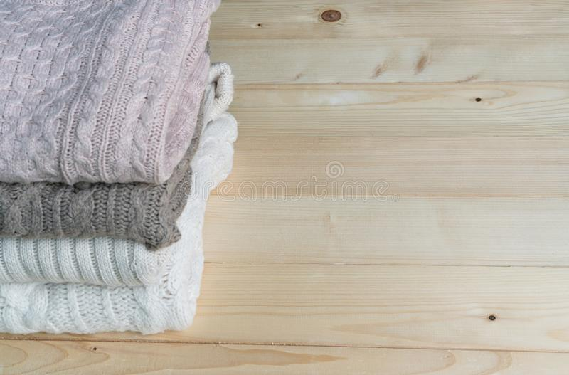 Stack of knitted winter clothes. Copy space royalty free stock photo