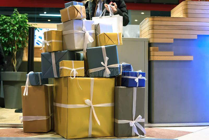 Stack of large gift boxes in wrapping paper, christmas holidays decor royalty free stock photo