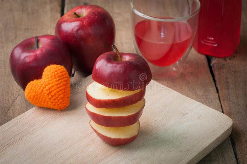 Stack layer of slice red apple on wood cutting board and apple j. Uice on glass - healthy eating and dieting food, concept of health care stock images