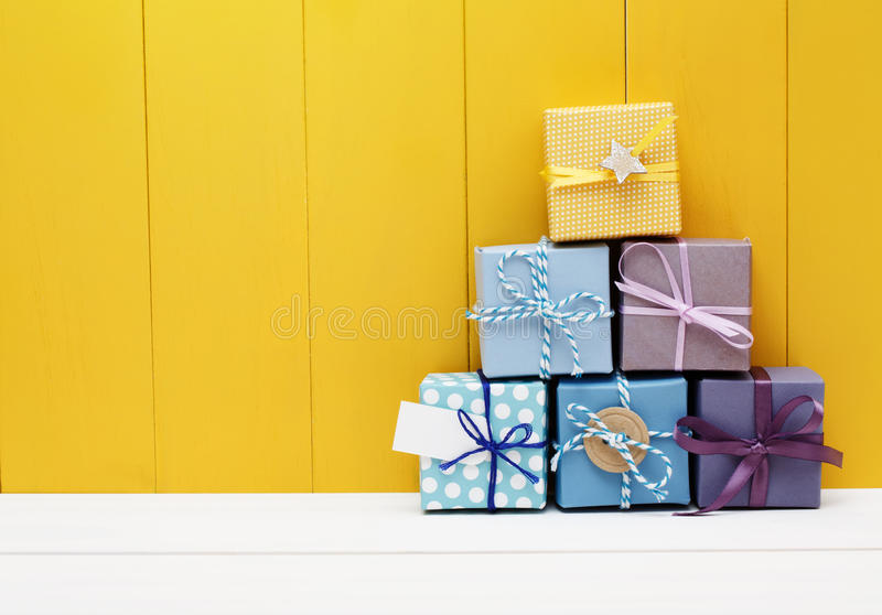 Stack of little present boxes stock photography