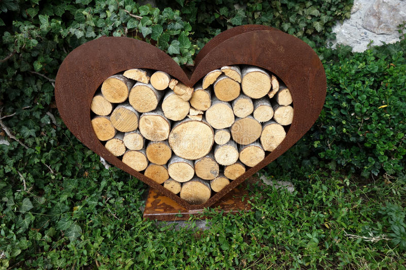 Stack of log wood in heart shape. Stack of log wood. shaped as heart stock images