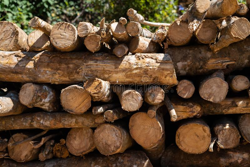 A stack of logs not neatly folded wall along and across stock photos