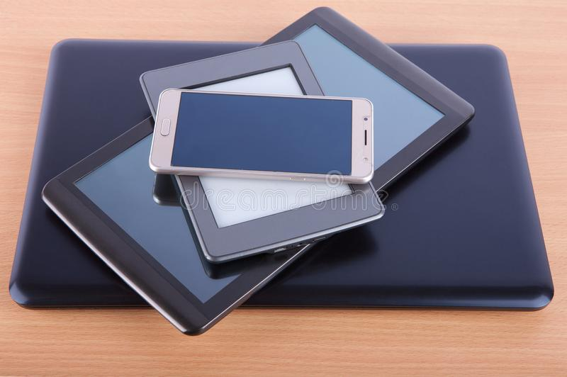 Stack made of different gadgets: from smartphone, ebook reader, royalty free stock image