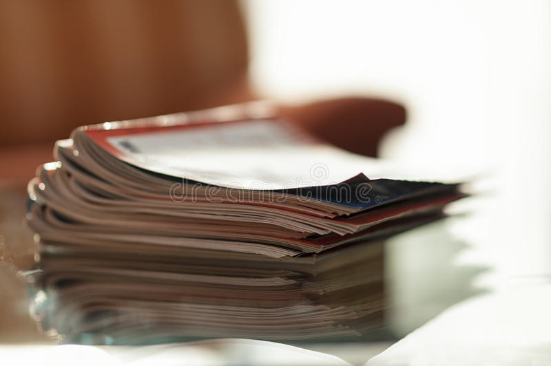 Download A stack of magazines stock photo. Image of glass, newspapers - 23239326