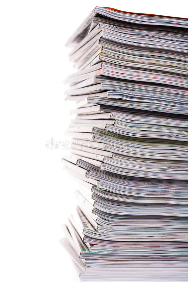 Stack of magazines. Isolated on white background royalty free stock photography