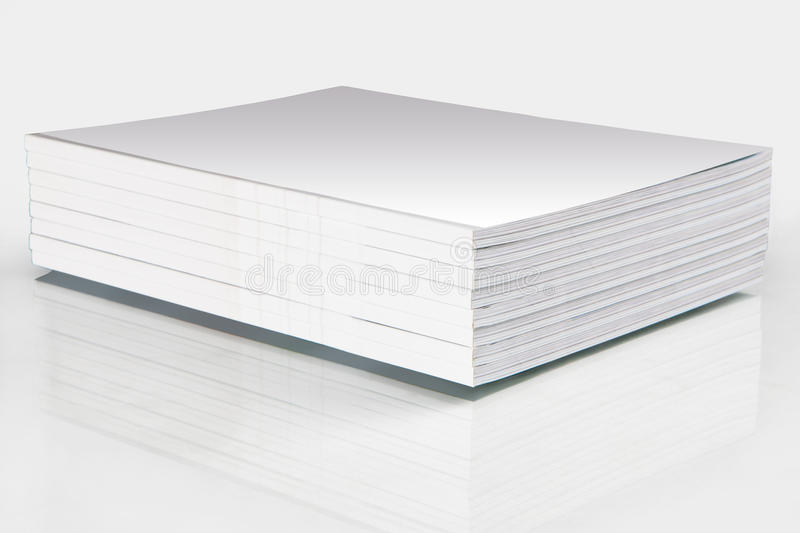 Stack of magazines with a blank cover royalty free stock image