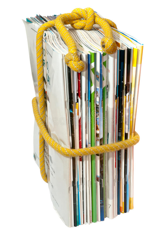 The stack of magazines on the rope stock photos