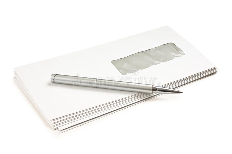 Stack of mail envelopes and a pen stock photos
