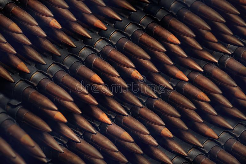 Stack of many bullets, old machine gun ammunition stock image