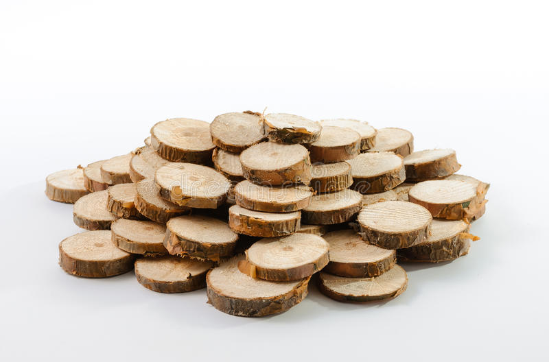 Stack of many little pieces of sawn pine branches. On white background royalty free stock photo
