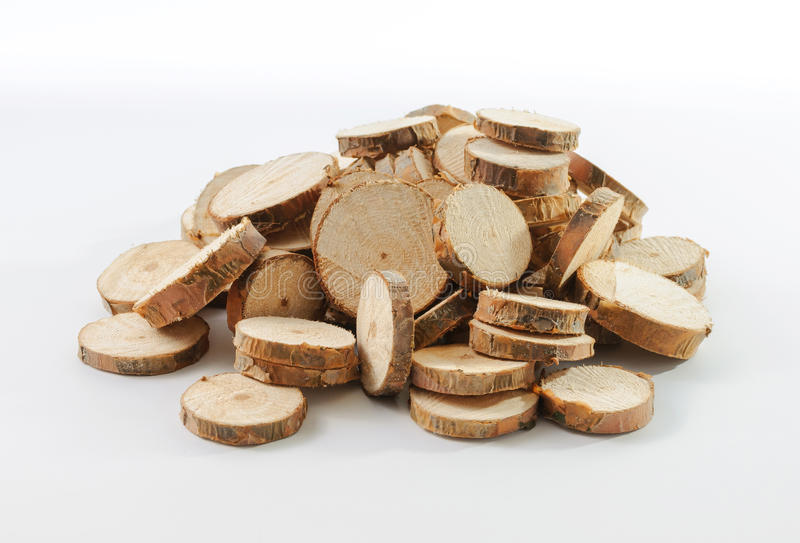Stack of many little round pieces of sawn pine branches. On white background stock image