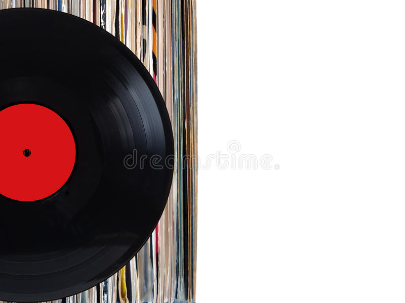 Stack of many vinyl records in old color covers on left side on photo on white background stock photography