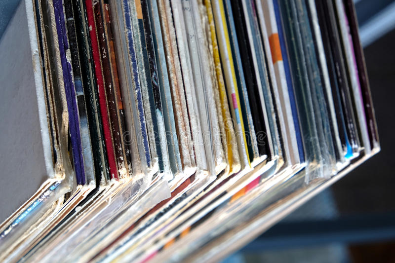 Stack of many vinyl records in old color covers on a shelf top view royalty free stock images