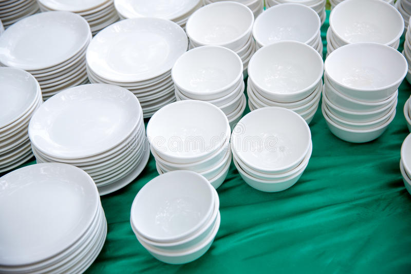 Download Stack Of Many White Plates On The Table To Prepare For Catering Buffet. Tableware & Stack Of Many White Plates On The Table To Prepare For Catering ...