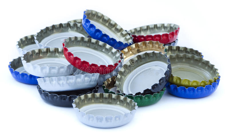 Isolated Metal Bottle Caps Pile royalty free stock photos
