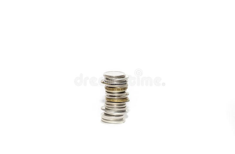 A stack of metal coins. On a white background, isolate stock photo