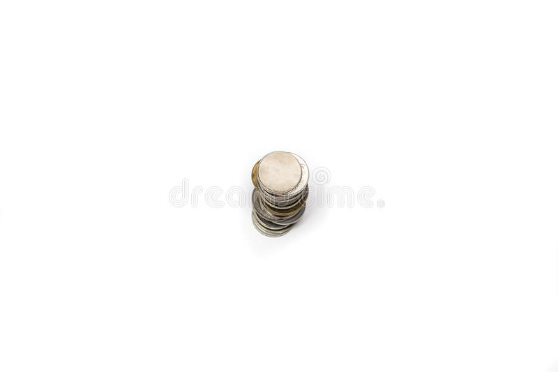 A stack of metal coins. On a white background, isolate stock photography