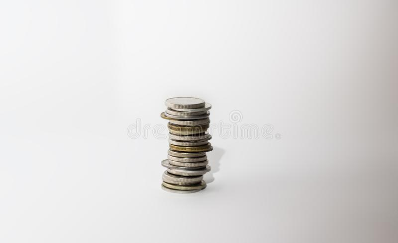 A stack of metal coins. On a white background, isolate stock photos