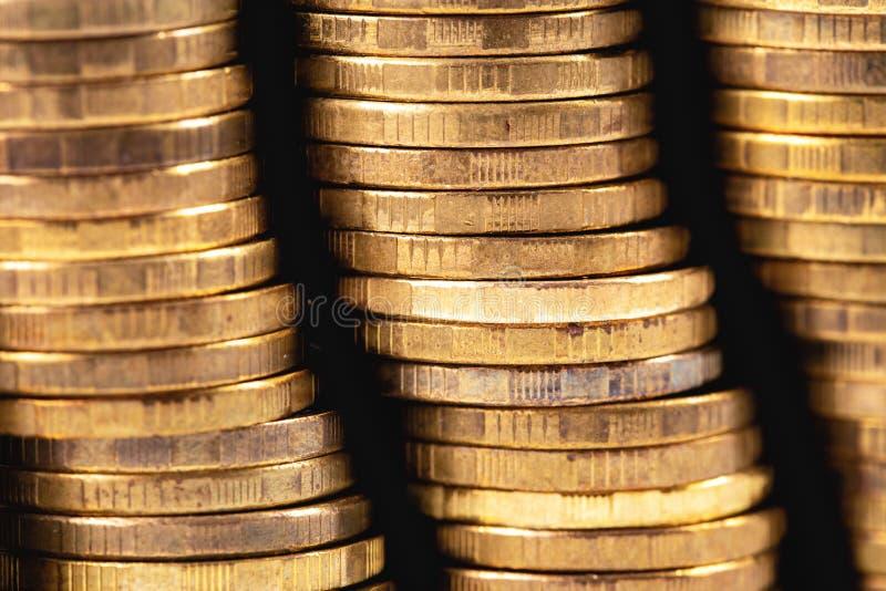 Metal coins money. Stack of metal golden coins money, closeup macro royalty free stock images