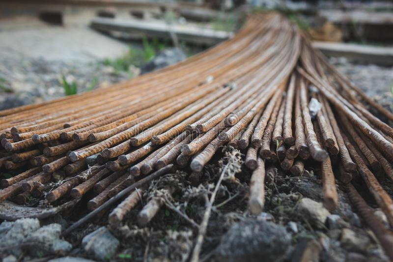 Stack of the metal rusty reinforcement bars royalty free stock photo