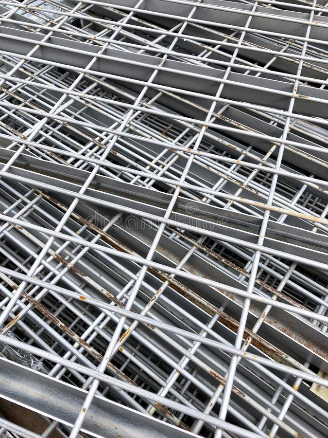 Stack of metal shelves with rust. Showing on some of them stock photos