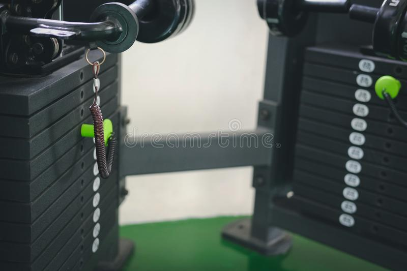 Stack metal weights equipment machine for bodybuilding training. In sport gym fitness club center stock images