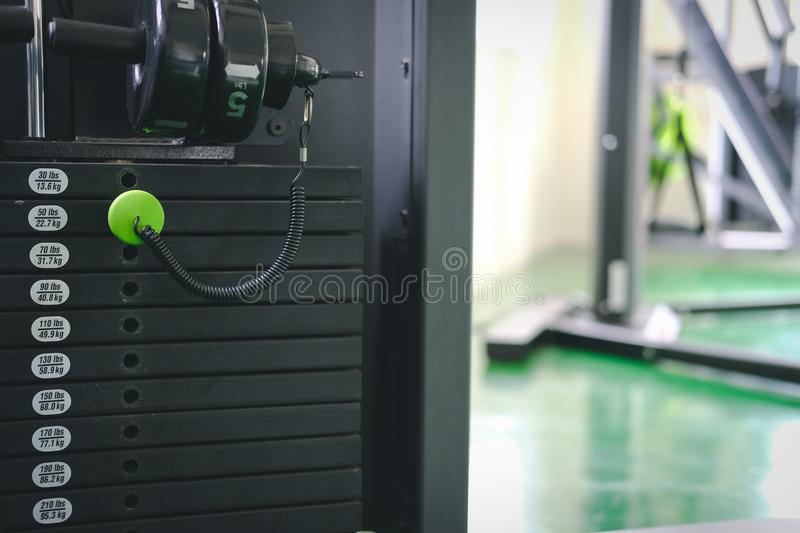 Stack metal weights equipment machine for bodybuilding training. In sport gym fitness club center royalty free stock photos