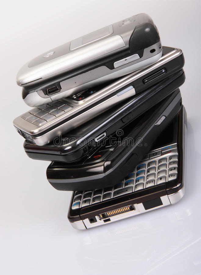 Stack of mobile phones stock image