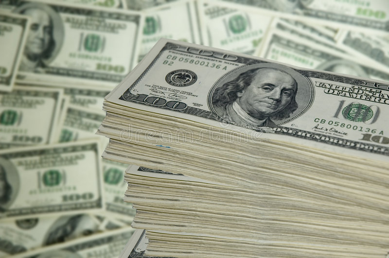 Stack of Money. A stack of 100 dollar bills on a blurred money background royalty free stock image