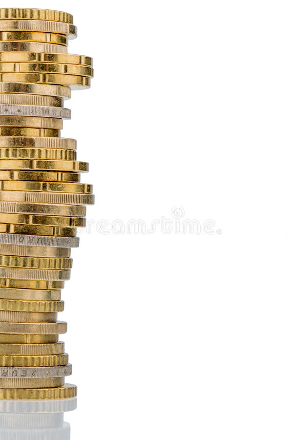 Stack of money coins in front of white background stock images