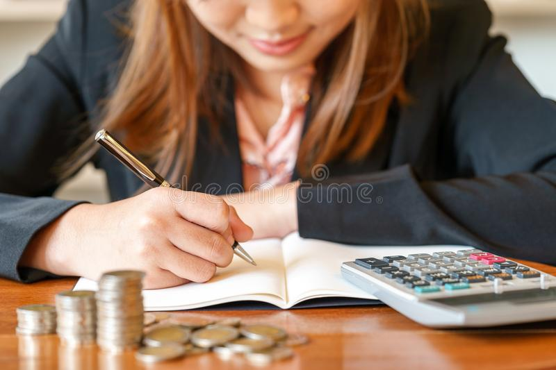 Stack money for growing chart of coins in font of businesswoman royalty free stock photo