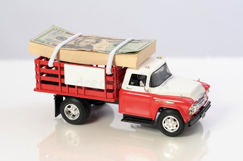 Stack of money on top of pickup truck stock images