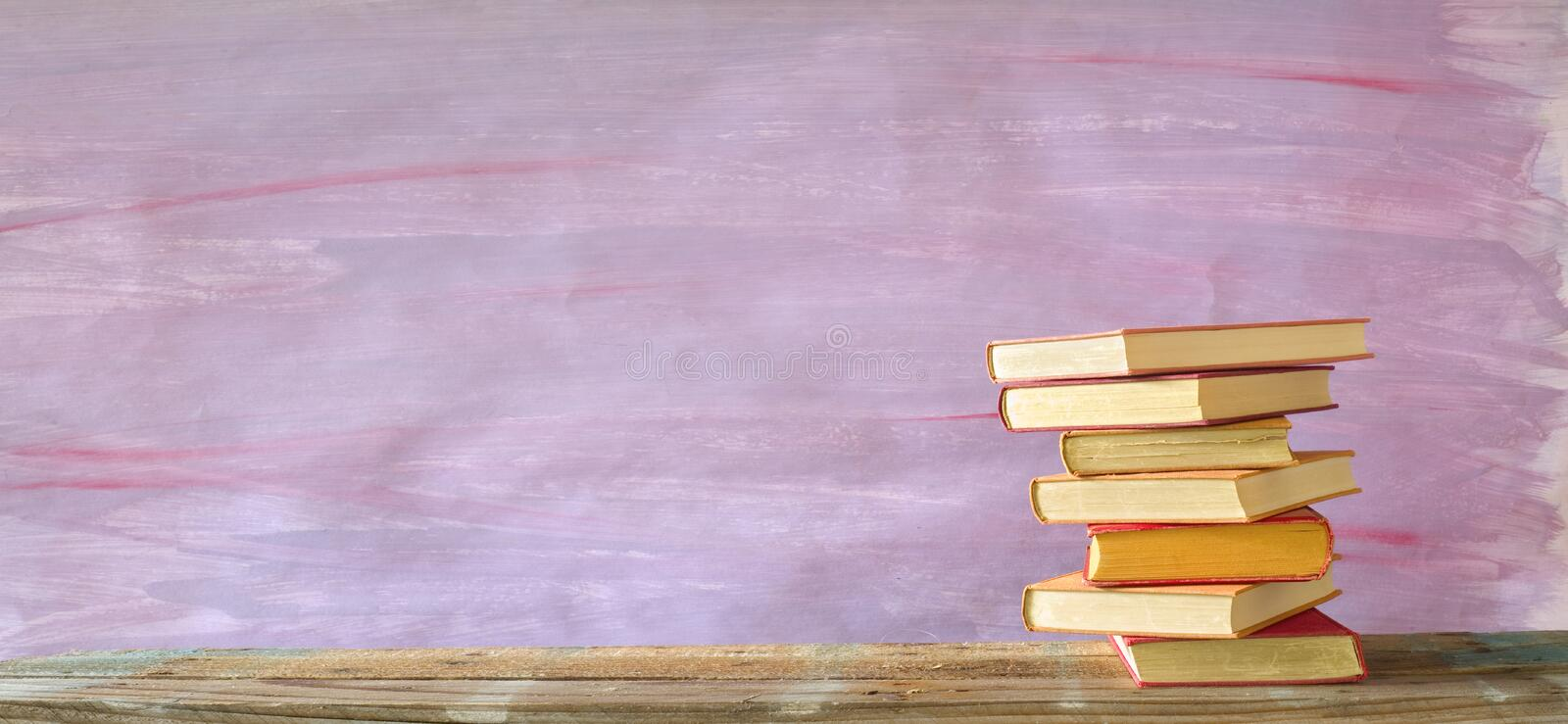 Stack of multicolored hardback books, reading, education, literature. Copy space stock image