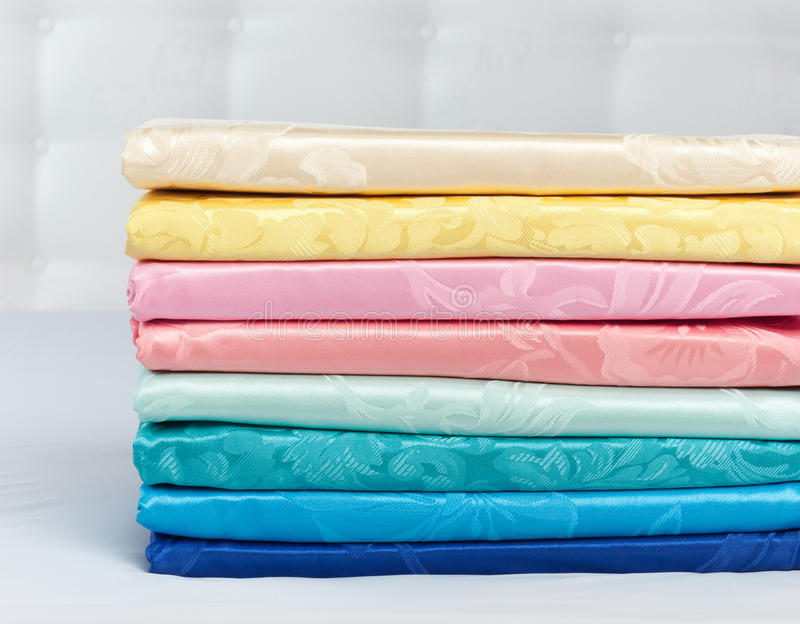 Stack Of Multicolored Silk Or Satin Blankets Royalty Free Stock Photography