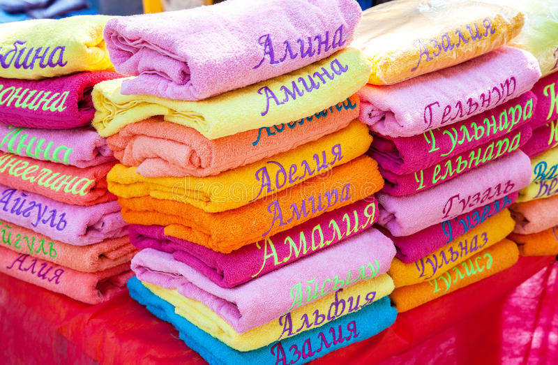 Stack of the multicolored towels with embroidered Tatar names stock photography