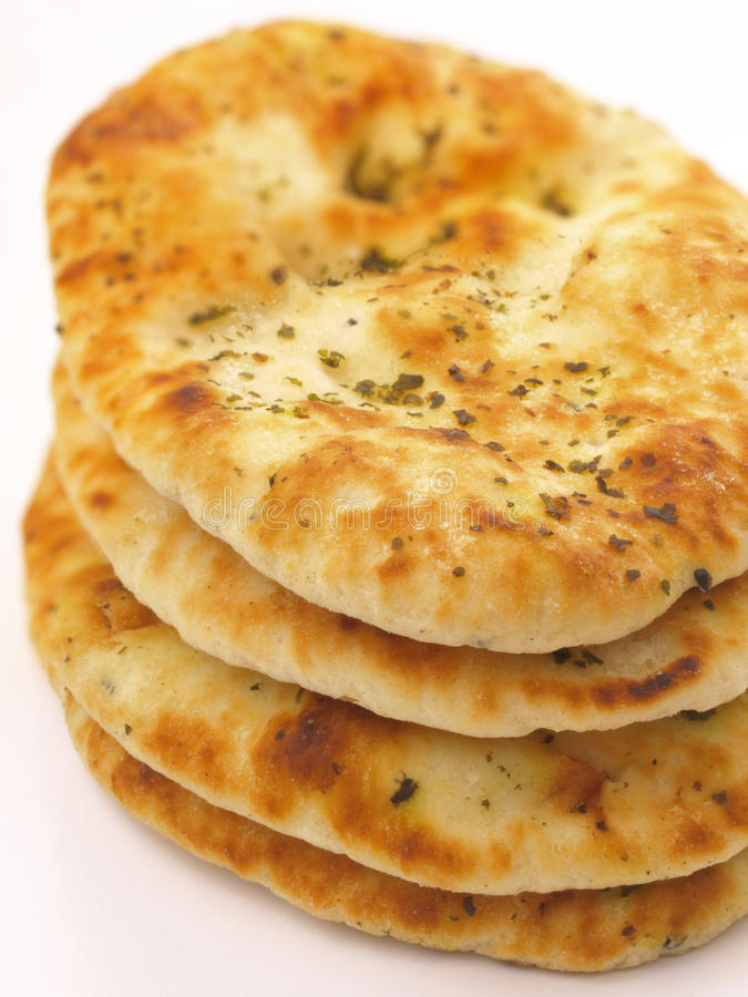 Stack of naan bread. A stack of indian naan bread royalty free stock photography
