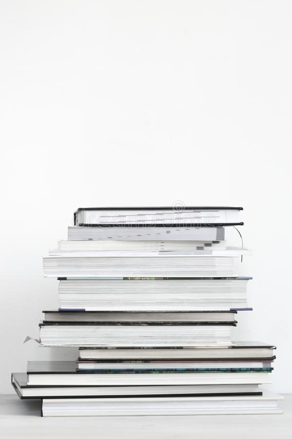 Stack of neutral colored books. Against white background stock photography