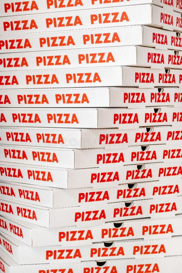 Stack of new cardboard pizza boxes royalty free stock images