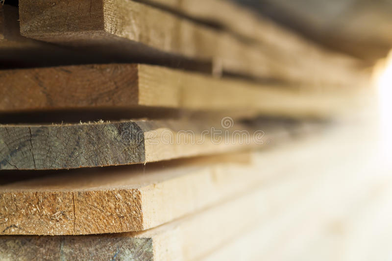 Stack of new wooden studs at the lumber yard. Wood timber construction material. royalty free stock photos