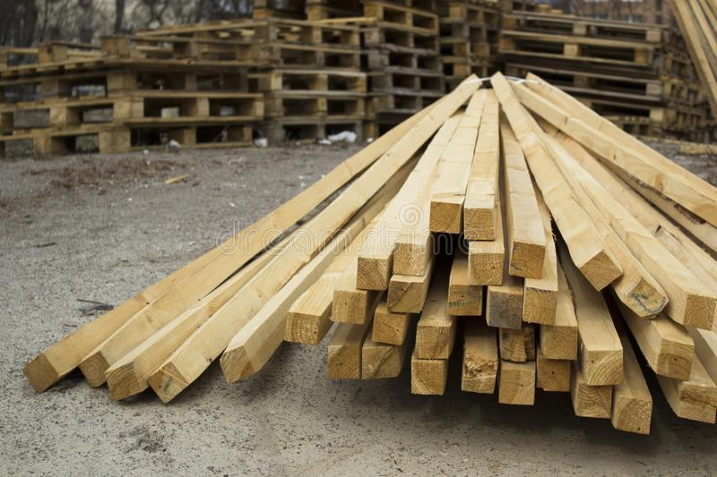 Stack of new wooden studs and pallets at the lumber yard stock photography