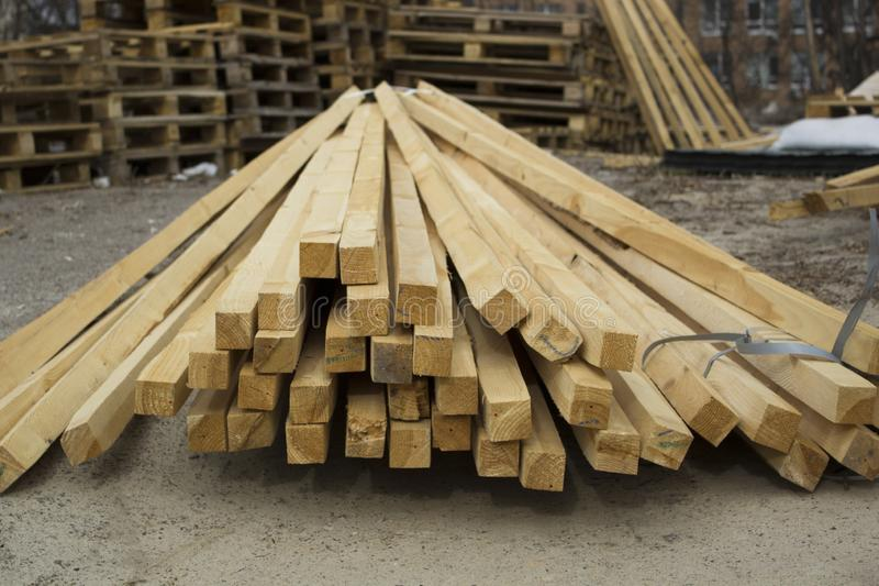 Stack of new wooden timber and pallets at the lumber yard royalty free stock photo
