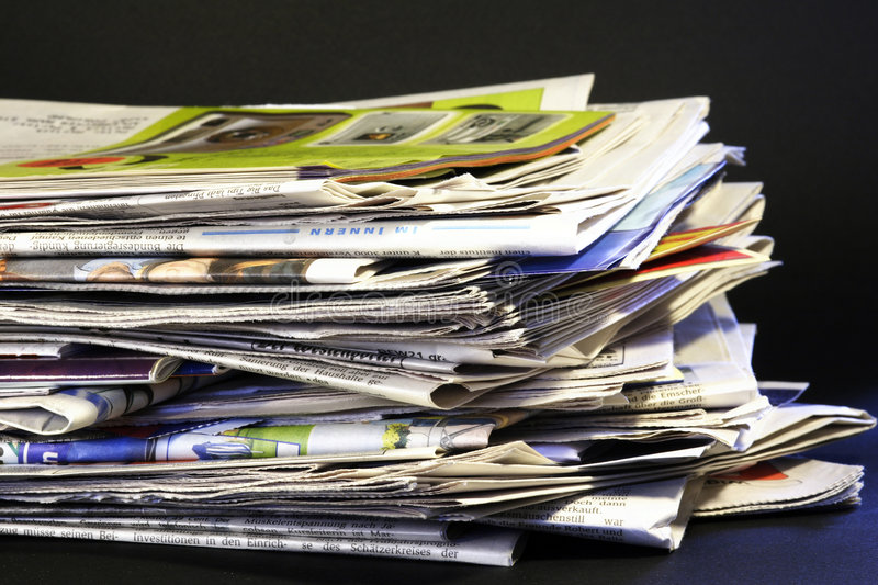 Daily stack of newspapers royalty free stock images