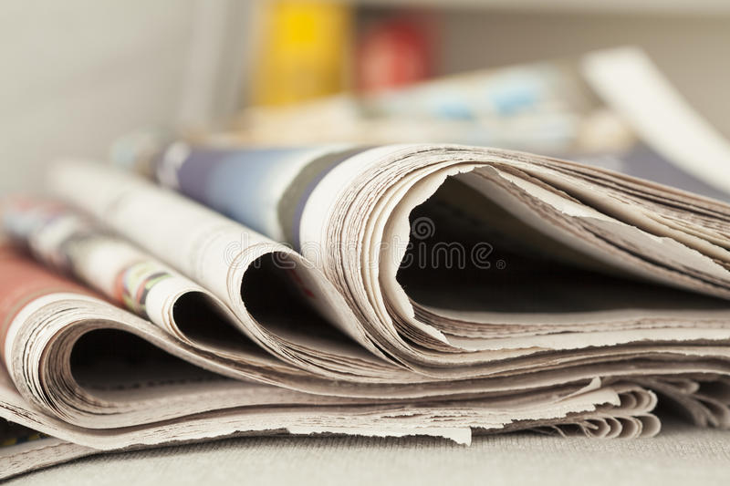 Stack of newspapers. Close up stock photography