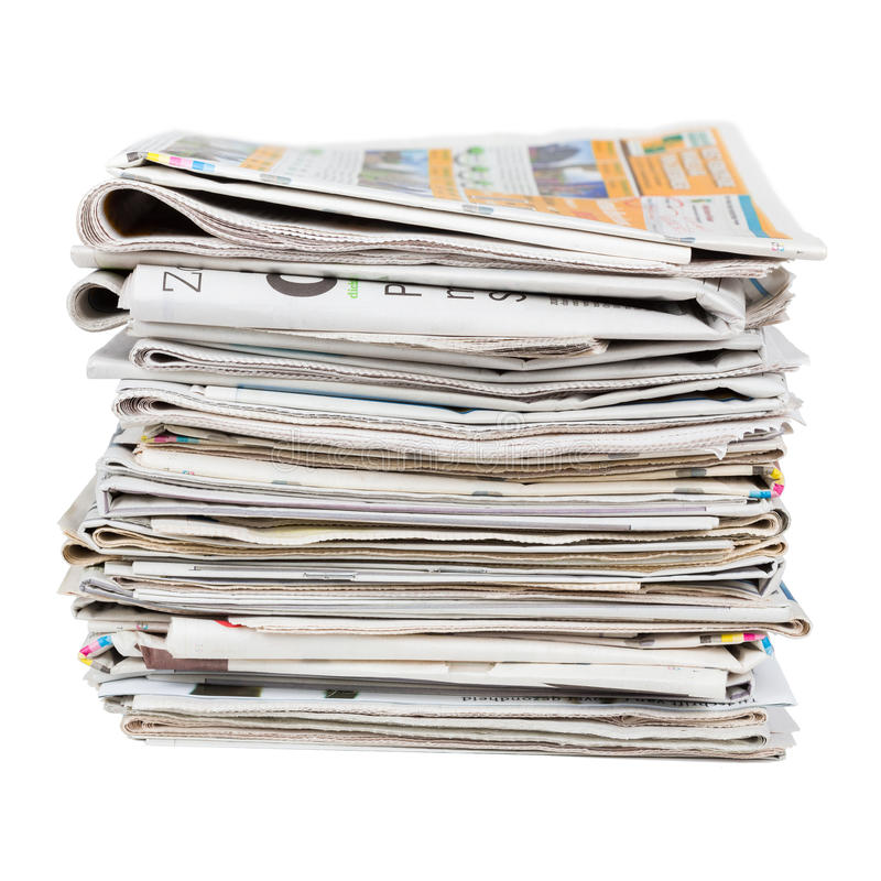 Stack of newspapers. Closeup shot. News and updates concept stock photos