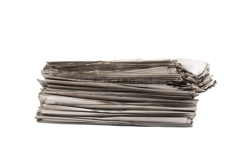 Stack of newspapers printed products closeup stock photo